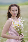 Portrait of girl with loose hair in chamomile field Royalty Free Stock Photography