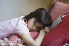 Portrait Of Girl Lying In Bed Stock Images