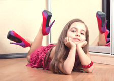 Portrait of a girl lying on the floor Stock Photo