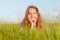 Spring Girl. Portrait of the girl lying in a green grass stock photography