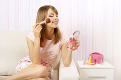 Portrait of girl with make-up brush Stock Photo