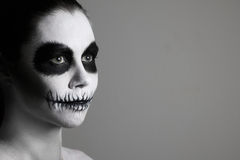 Portrait of girl with make-up for halloween. gray background, isolated. unusual body art. black and white. Halloween. Creative image. Facial mask Royalty Free Stock Photos
