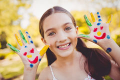 Portrait of a girl with make-up showing her painted hands Stock Photo
