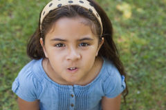 Portrait of a girl making faces at park Royalty Free Stock Images