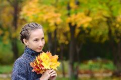 Portrait of Girl with maple leaves Royalty Free Stock Photography