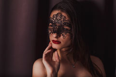 portrait of a girl in a mask stock photography