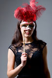 Portrait of a girl in a mask with red feathers Stock Photography