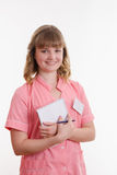 Portrait of girl in a medical shirt. Portrait of a young pretty girl medical worker on a white background royalty free stock photos