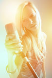 portrait of a girl with a microphone stock photography