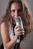 Portrait of a girl with a microphone Royalty Free Stock Image