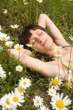 The portrait  of girl in the middle of flower Royalty Free Stock Image