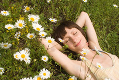 The portrait  of girl in the middle of flower Stock Photos