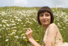The portrait  of girl in the middle of flower Stock Image