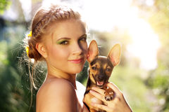Portrait of a girl with Miniature Pinscher Stock Photography