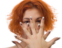 Portrait of a girl with nail art. Portrait of a red-hair girl with nail art Royalty Free Stock Photo
