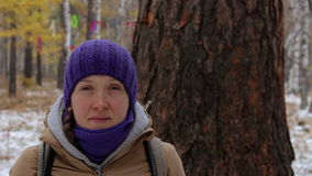 Portrait of a girl near a big old tree, larch. Close-up stock video footage