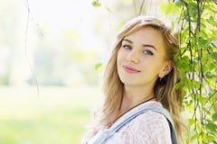 Portrait of a girl near birch, close-up Stock Photos
