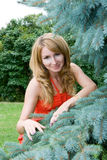 Portrait of girl near a fir-tree. Portrait of young girl in red clothes near a fir-tree Royalty Free Stock Photos
