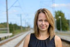 Portrait of girl near railway path Stock Photos