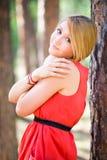 Teen girl near the tree. Young girl posing near the tree Royalty Free Stock Image