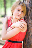 Pretty girl near the tree Royalty Free Stock Photo