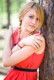 Pretty girl near the tree. Young girl posing near the tree Royalty Free Stock Photo