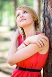 Girl posing near the tree. Young girl posing near the tree Stock Image