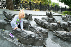 Portrait of a girl next to the bronze horses. Girl near the monument with bronze horses Stock Image