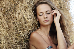 Portrait of a girl next to haystack Stock Images