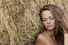 Portrait of a girl next to haystack Royalty Free Stock Photo