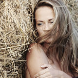 Portrait of a girl next to haystack Stock Photo