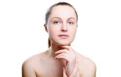 Portrait of a girl with nude make-up with hands on chin. Isolated on white background. Girl with clean healthy skin on white. Cosmetology, spa, medicine, beauty Stock Photography