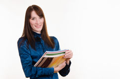 Portrait of girl in office clothes and with magazines Stock Photo