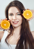 Portrait of a girl with an orange Royalty Free Stock Photos