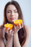 Portrait of a girl with an orange Royalty Free Stock Photo