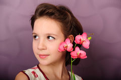 Portrait of a girl with orchids in the hands Royalty Free Stock Photos