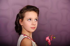 Portrait of a girl with orchids in the hands Royalty Free Stock Photo