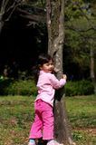 Portrait - Girl Outdoor. Girl standing by a tree in early spring at the park Royalty Free Stock Image