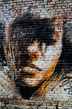 Portrait of a girl in the paint on the wall Stock Image