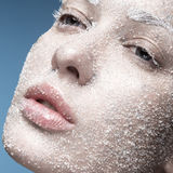 Portrait of girl with pale skin and sugar snow on. Portrait of a girl with pale skin and sugar snow on her face. Creative art beauty fashion. Picture taken in stock photo