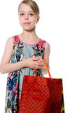 Portrait of girl with paper bags for shopping. Stock Photography