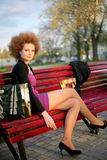 Portrait of a girl in the park after shopping. Portrait of a girl relaxing after shopping Stock Photo