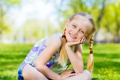 Portrait of a girl in a park Stock Images