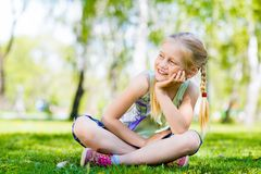 Portrait of a girl in a park Royalty Free Stock Photos