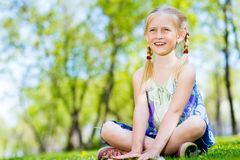 Portrait of a girl in a park Royalty Free Stock Image