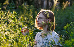 Portrait of a girl in park in summer. Portrait of a teenage girl in summer park at evening sunshine Royalty Free Stock Images