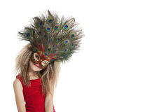 Portrait of a girl in peacock feather mask over white background Stock Photo