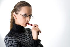 Portrait of a girl with pen Stock Images