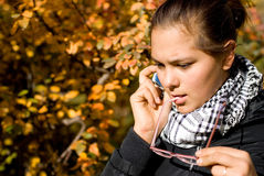 Portrait of girl with phone. Portrait of girl. The photo is made in October 2009 Royalty Free Stock Photography
