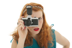 Portrait girl with photo camera and red hair Royalty Free Stock Photos
